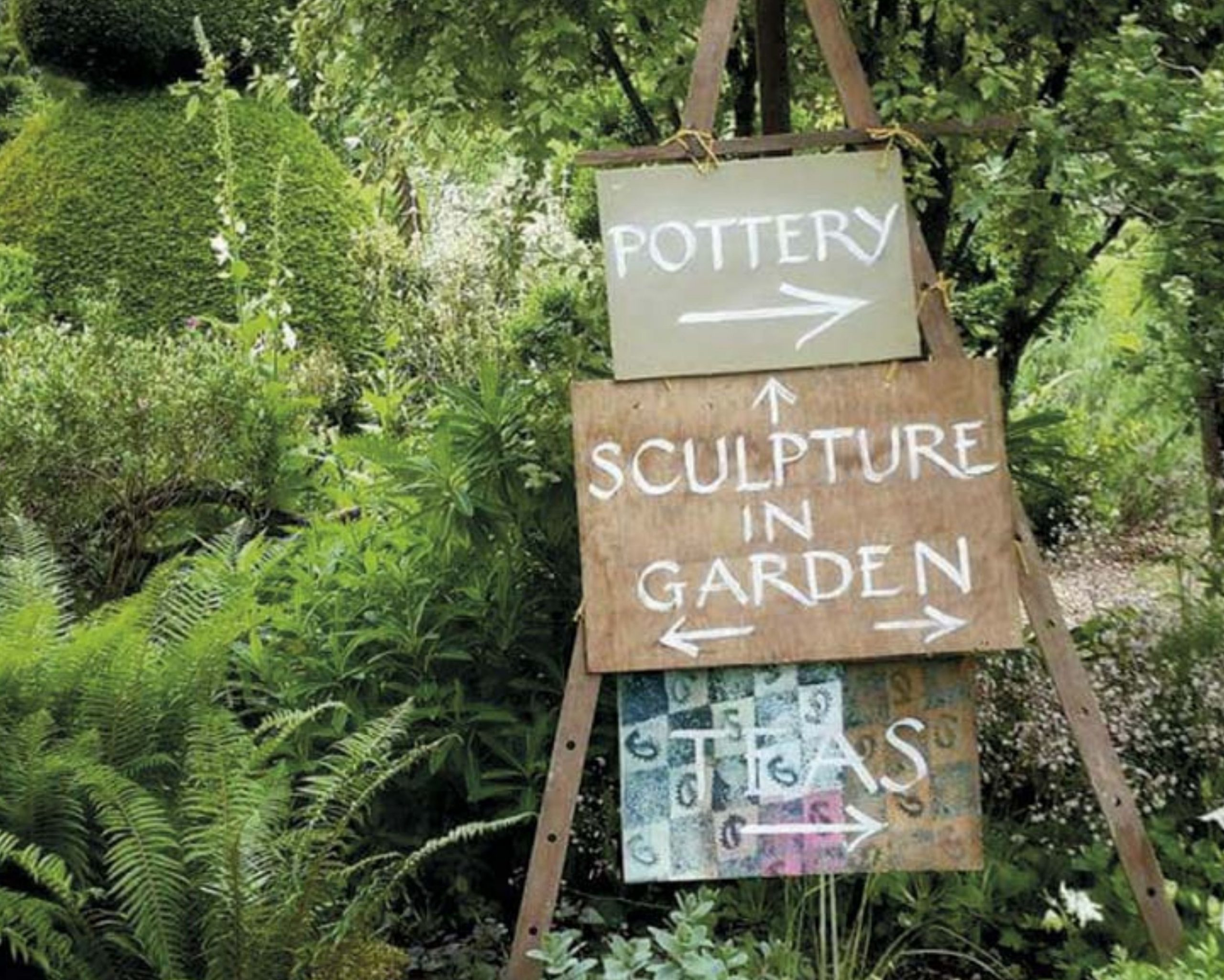 signage in a garden for the Wealden Literary Festival