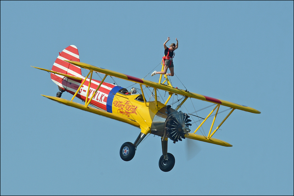 Biplane with person on top wing