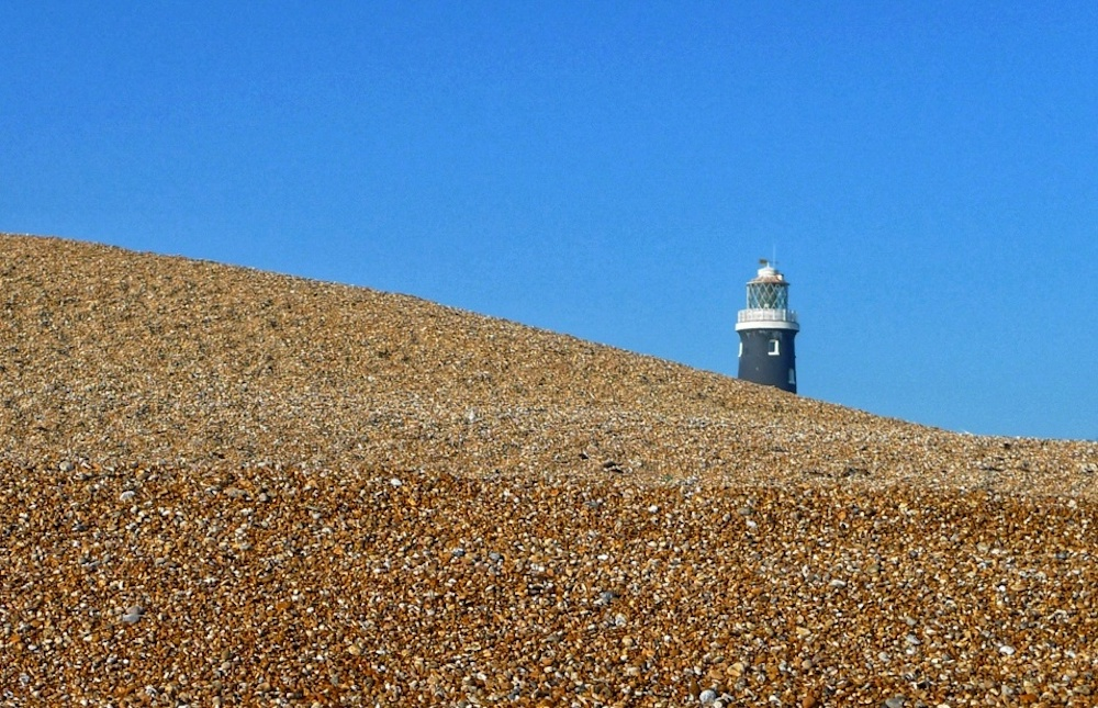 Shingle beach with lighthouse
