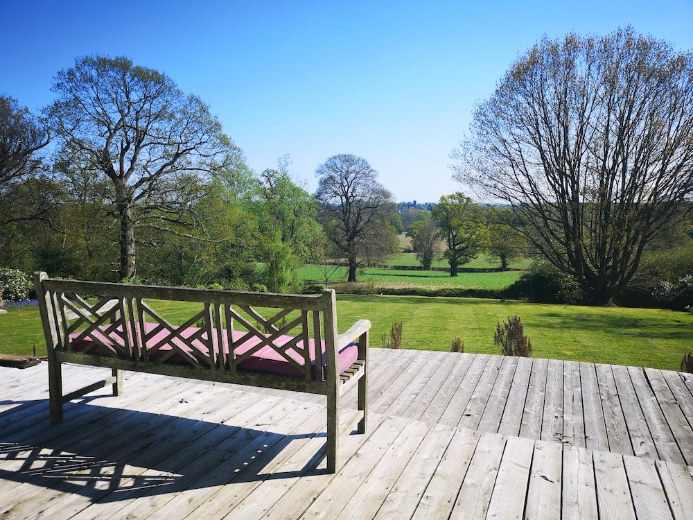 bench in sunshine with countryside views