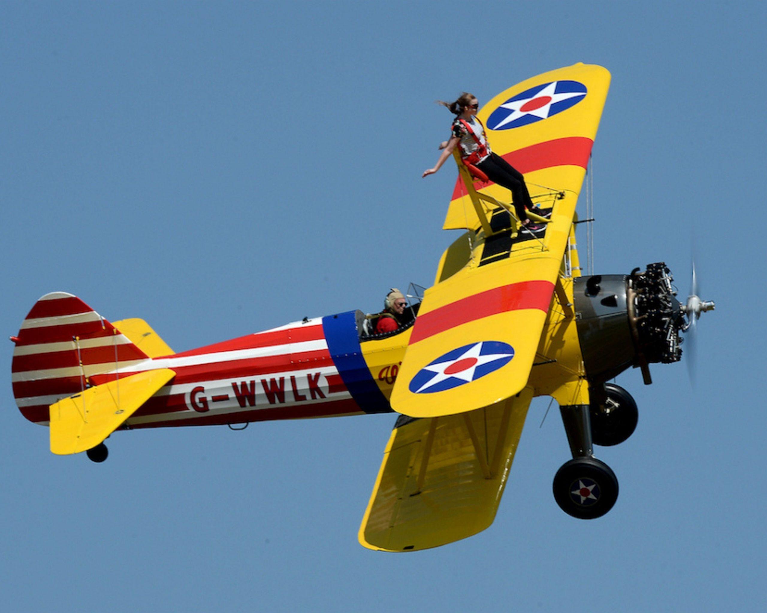 Wing walker on top of biplane wings