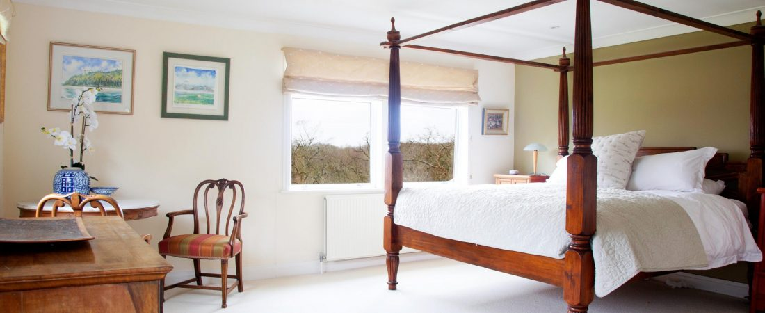 Four poster bed in master bedroom at Barnfield House Kent
